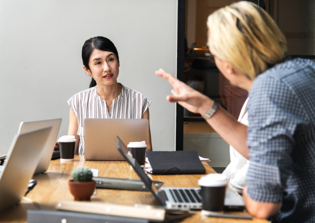 conversation business people at desk conversational sales adroit insights
